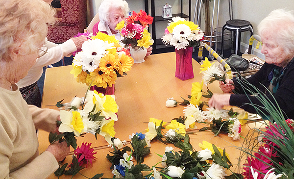 Residents making flower vases